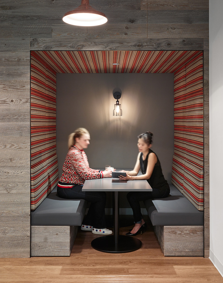 Acoustic paneling dampens sound so lively conversations don't bother colleagues