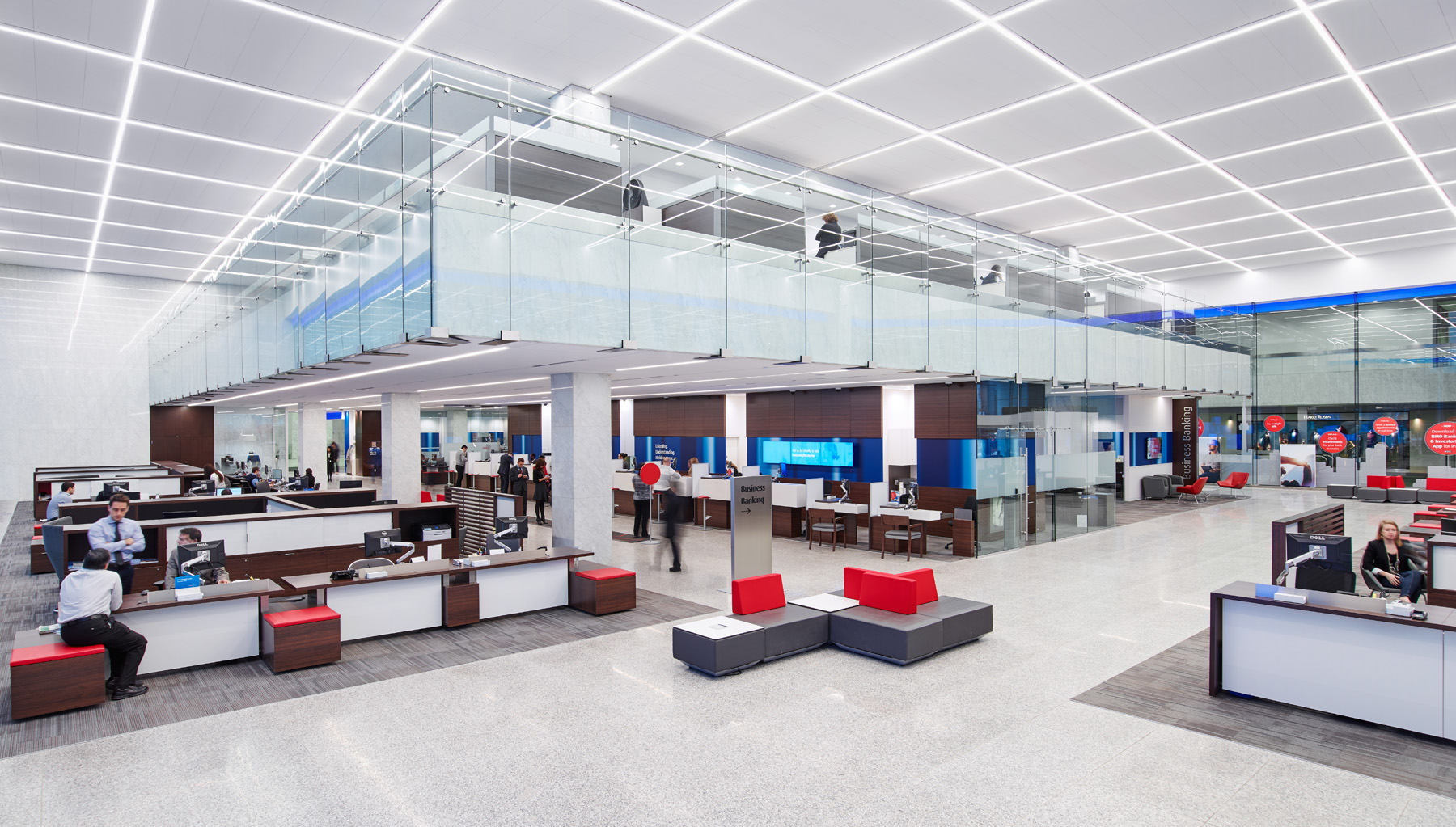 BMO interior with workstations, upholstered seating, and second floor with glass walls