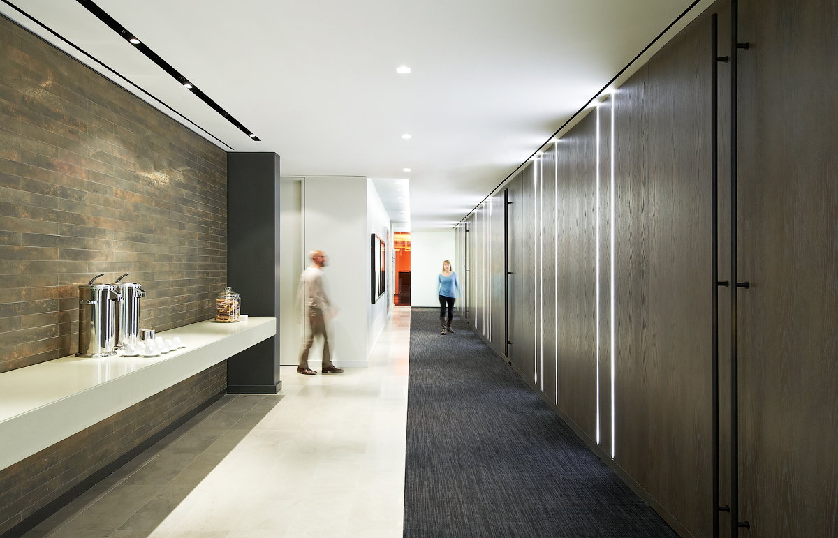 Baker & McKenzie hallway with wood doors on one side and coffee bar on other side