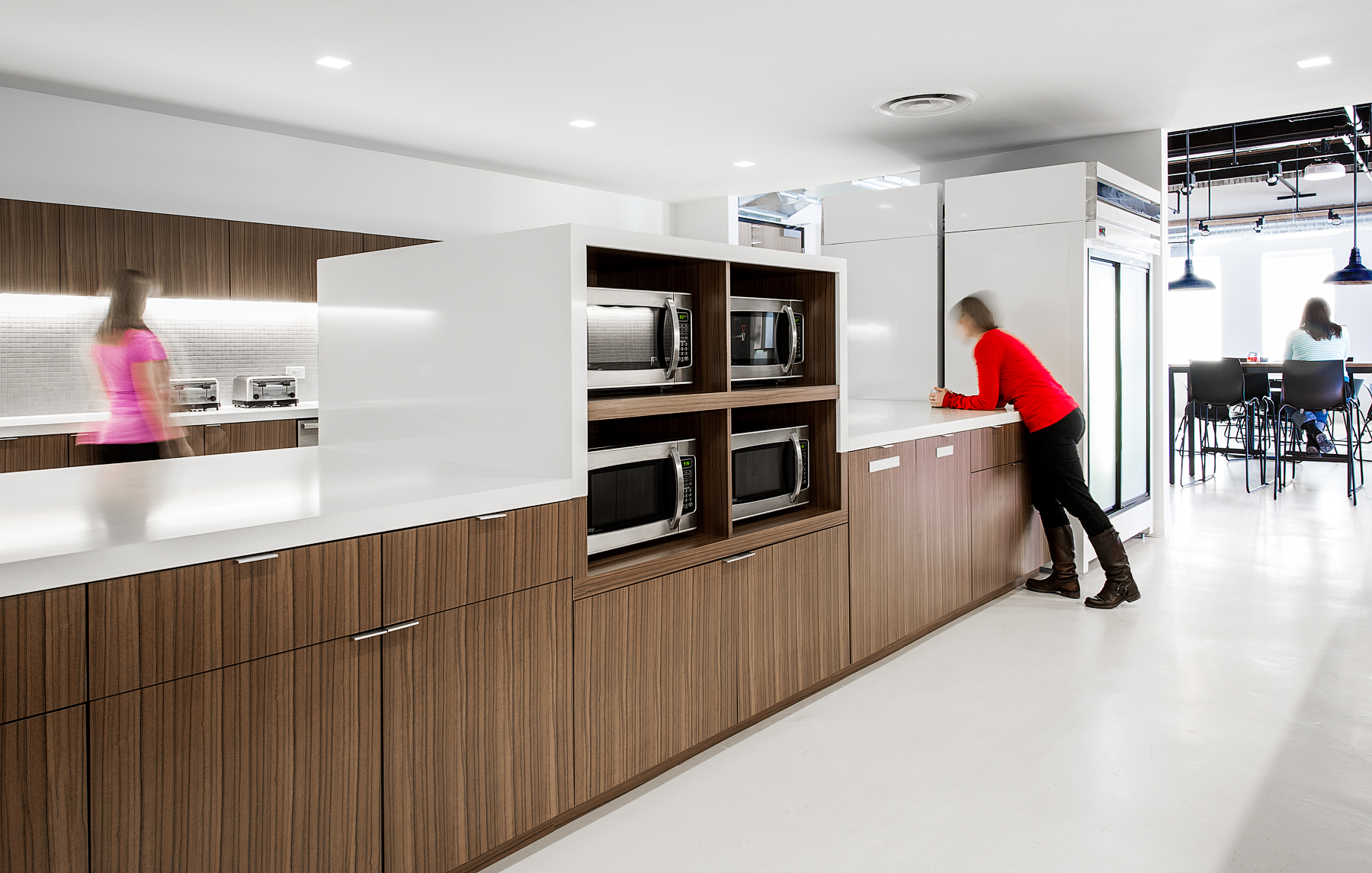 Canada Goose kitchen with wood cabinets, white countertops, and white floors