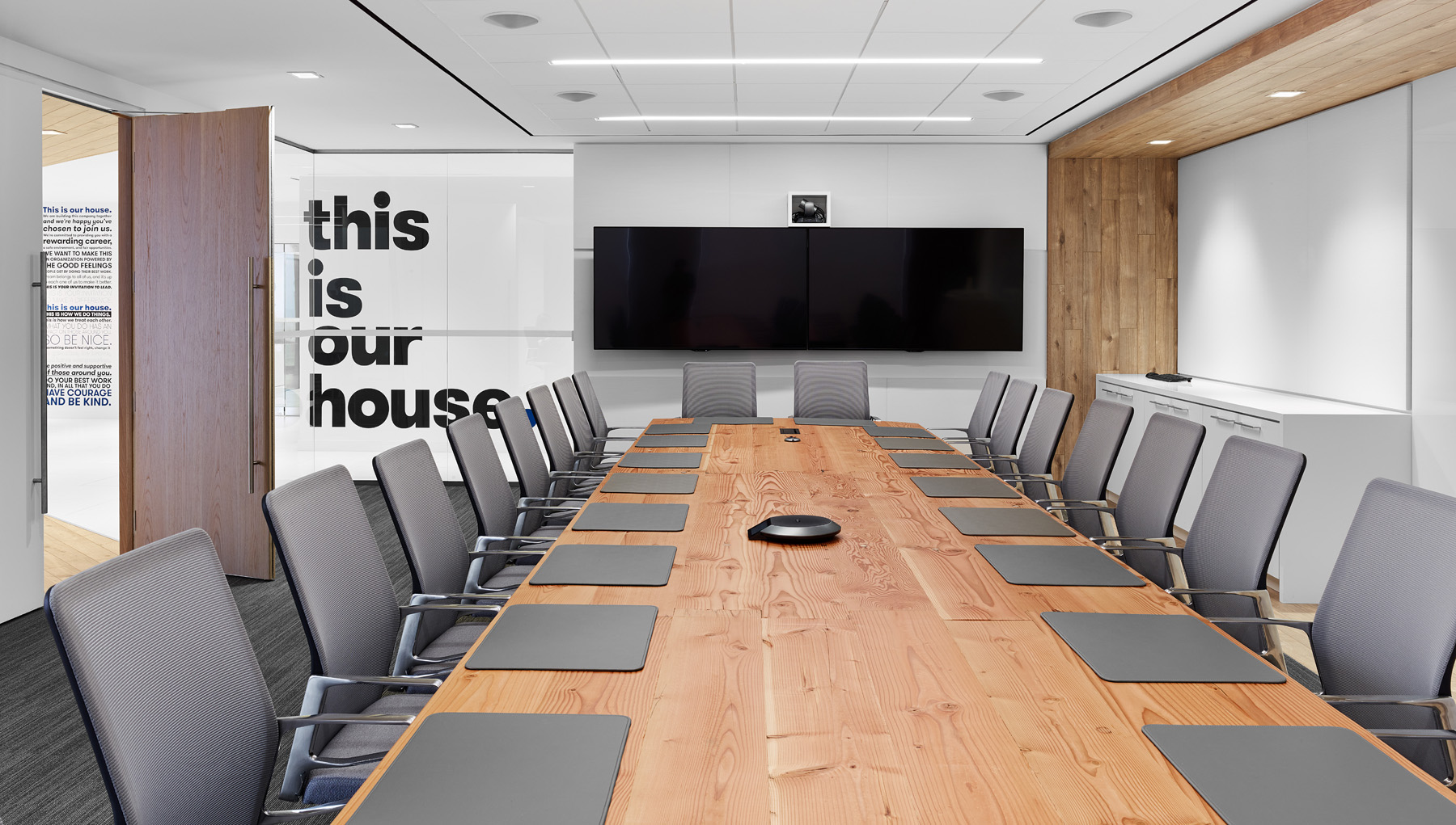 Dream Office REIT boardroom with long wood table and