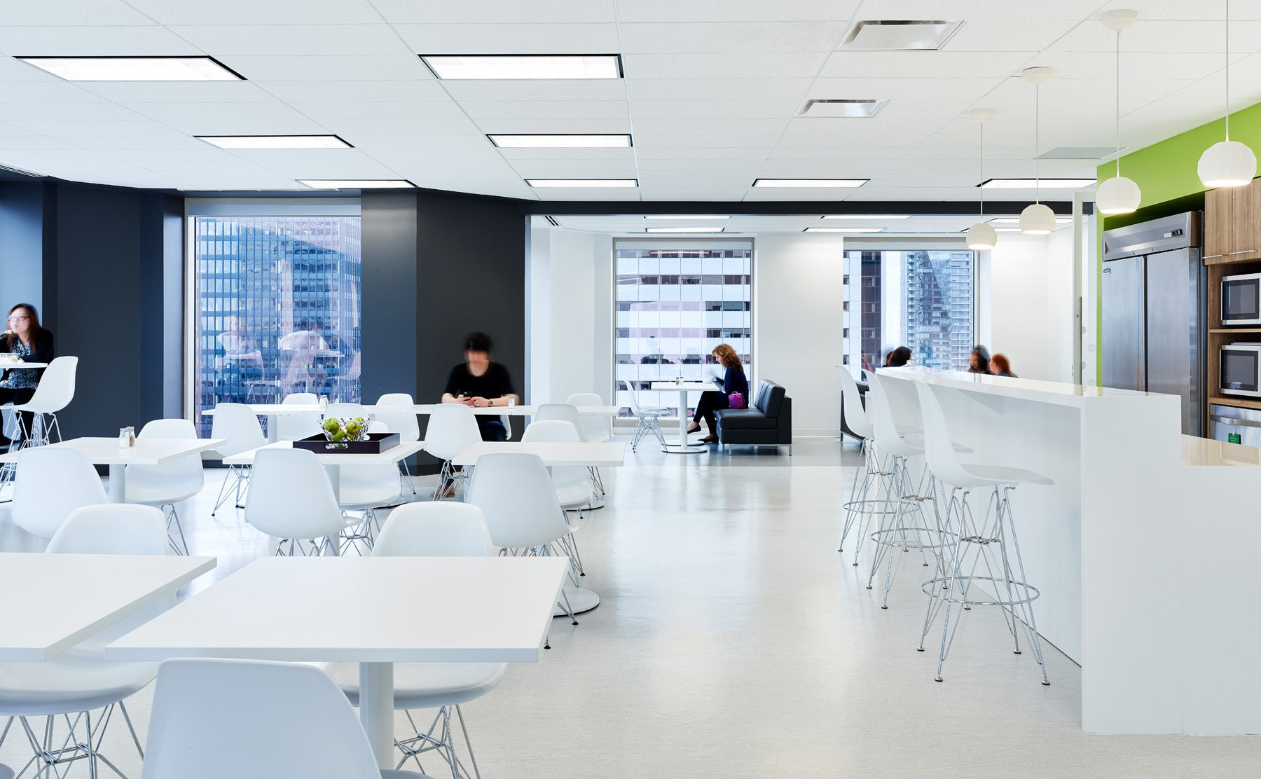 Dream Office REIT lunchroom with all white kitchen with white tables and chairs