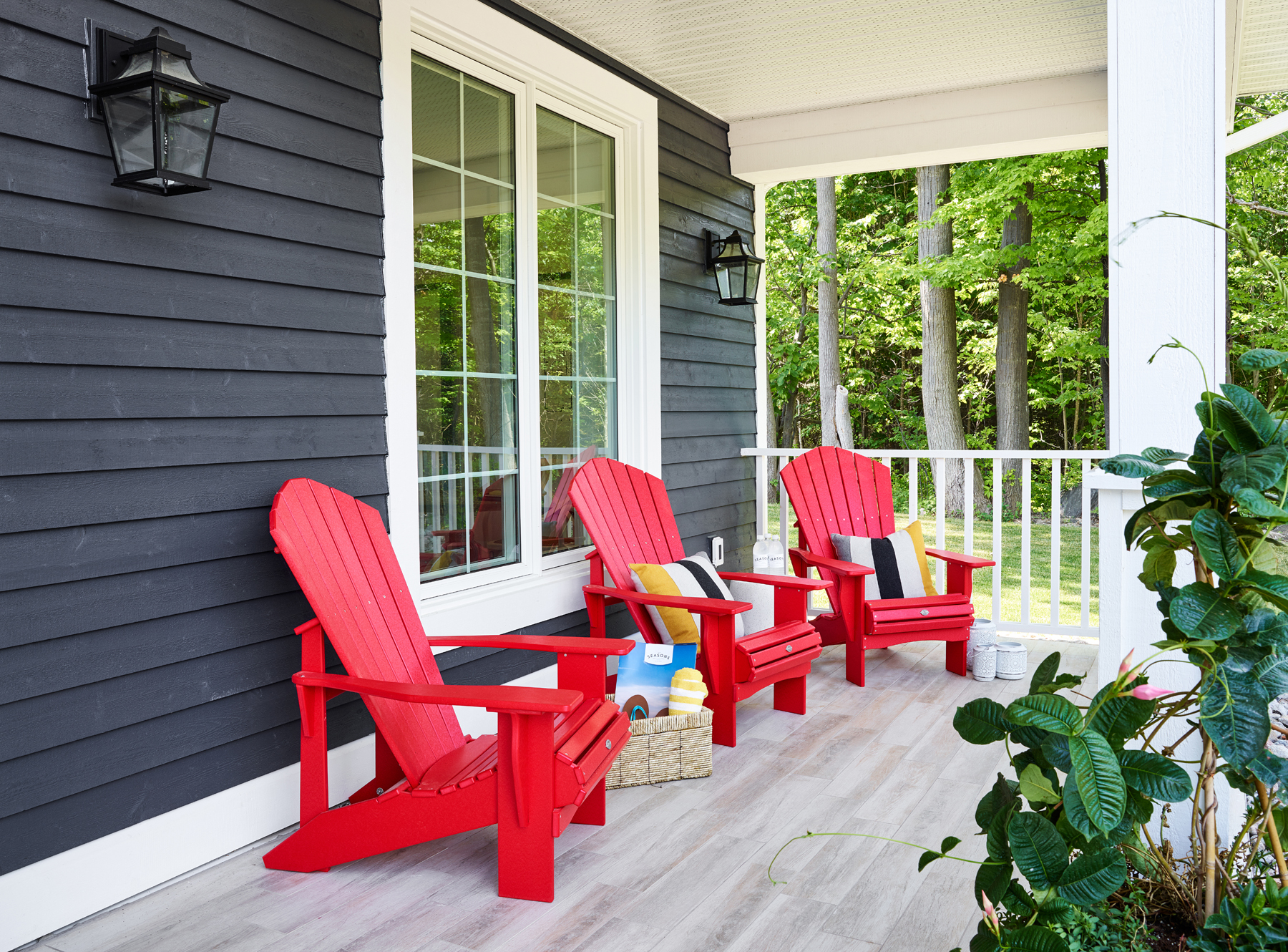 Seasons on Little Lake porch with red wood chairs