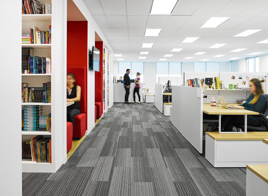 Penguin Random House workspace with desks on right and booths on left