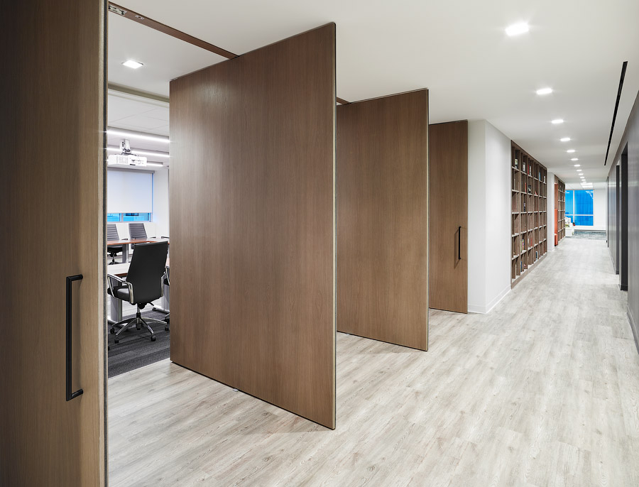 Penguin Random House walkway with bleached wood floors and natural wood room dividers