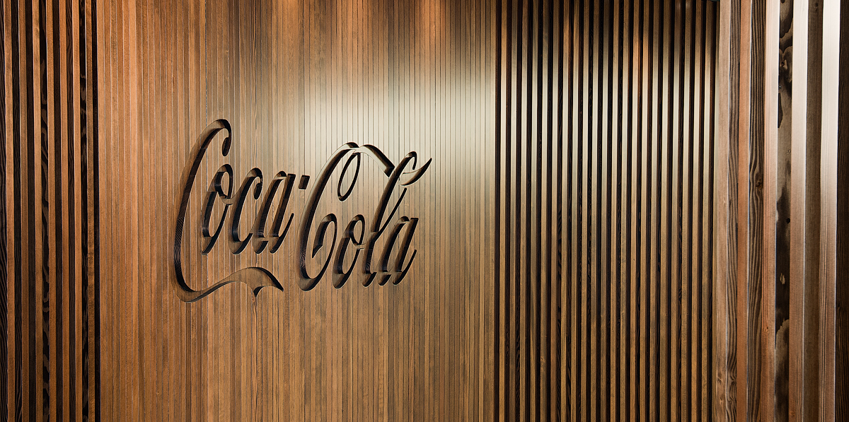 Coca Cola detail of wood wall engraved with Coca Cola logo
