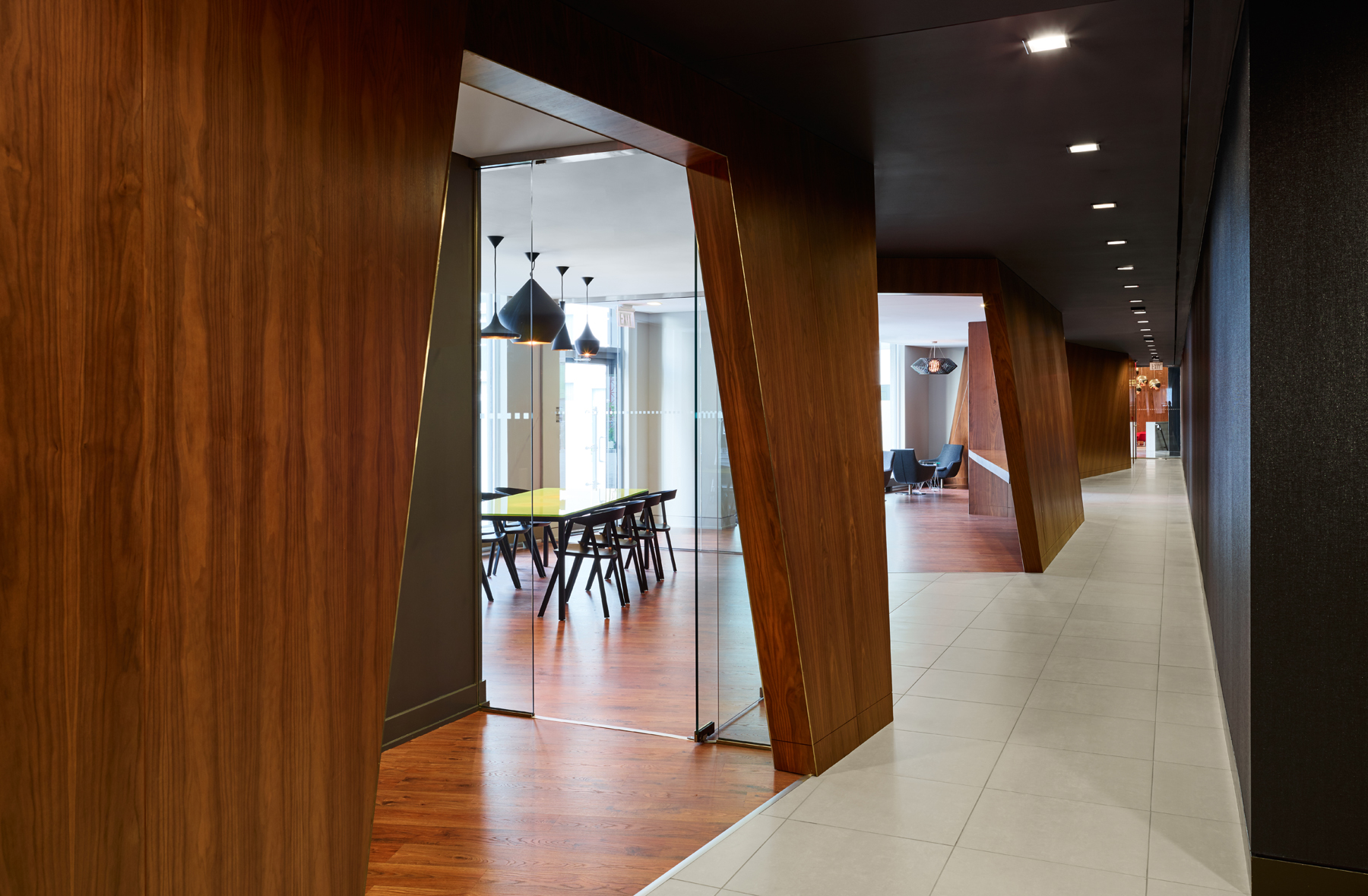 Concord Quartz communal rooms with dark wood walls and seating inside