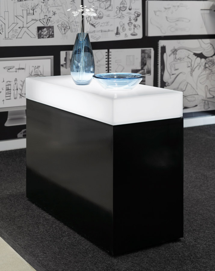 Umbra Toronto detail of black display table with white top displaying blue glass vase and bowl