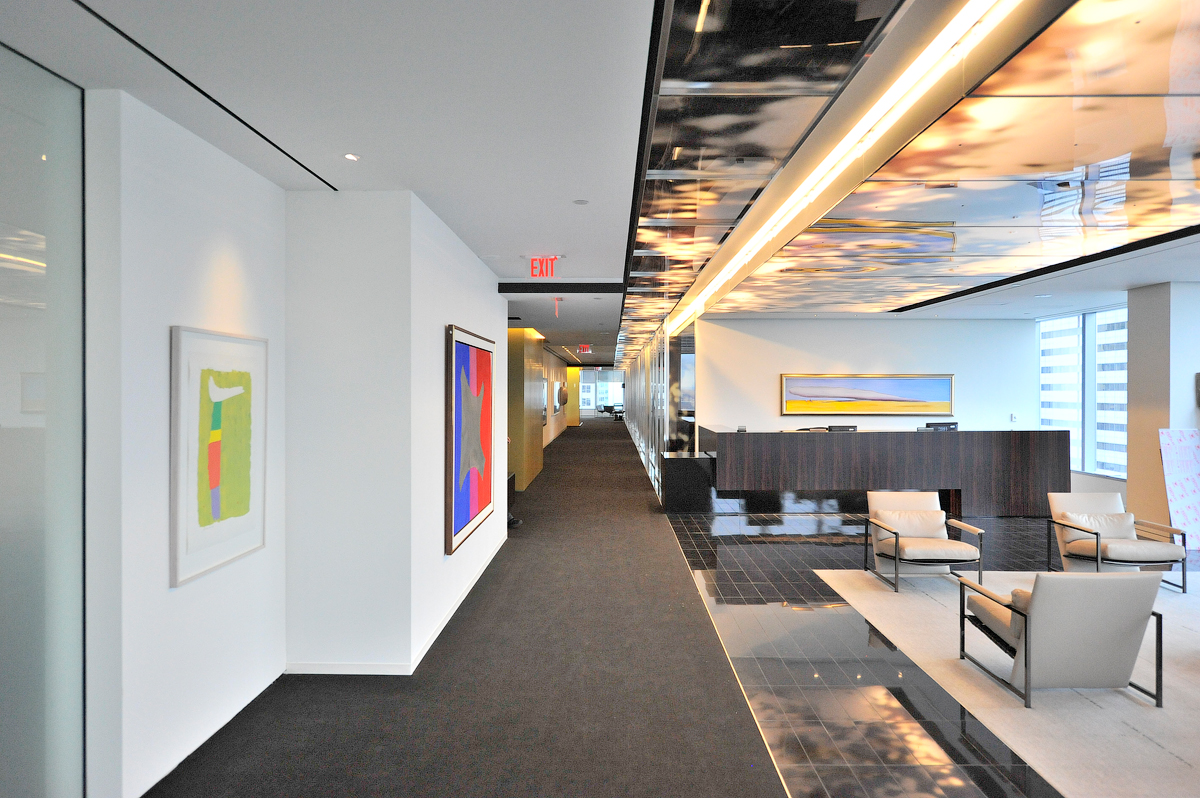 Goodmans lobby with seating area, next to hallway with colourful abstract paintings