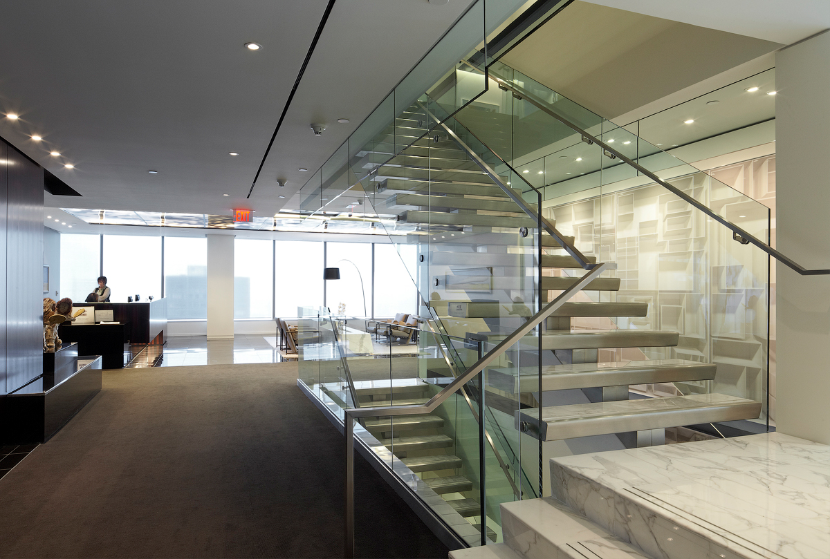 Goodmans staircase with glass walls and white marble steps