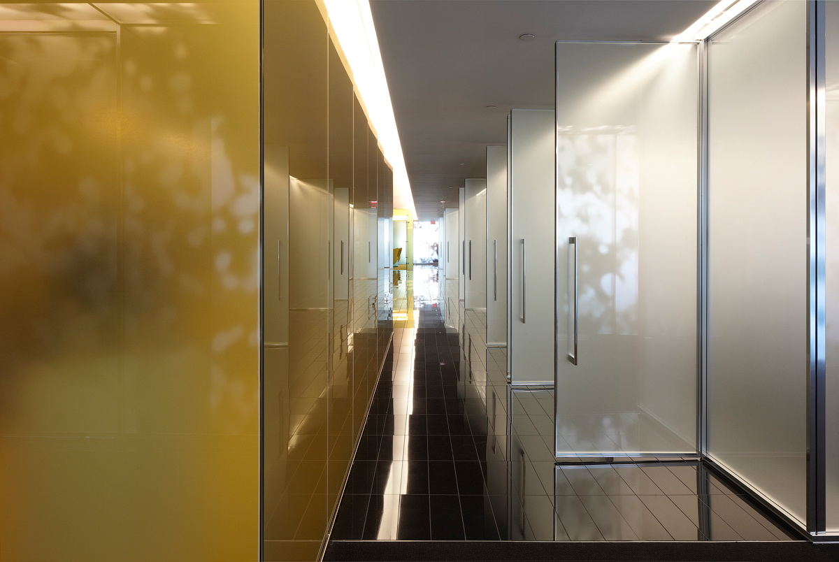 Goodmans hallway with gold wall and frosted glass doors