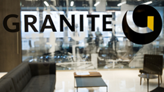 Granite Toronto glass wall with logo in black and yellow
