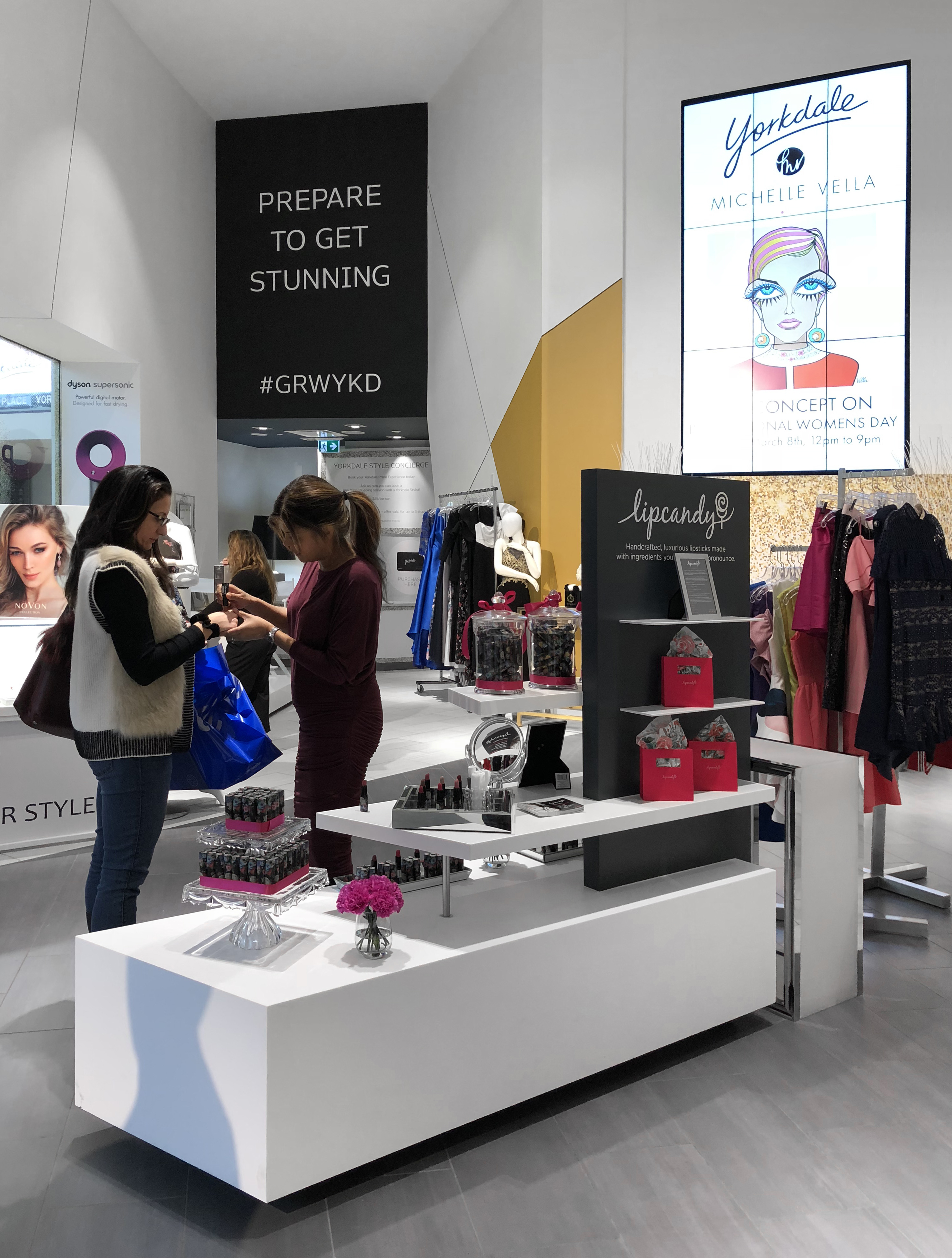 Concept Yorkdale accessories table with shoppers and salespeople