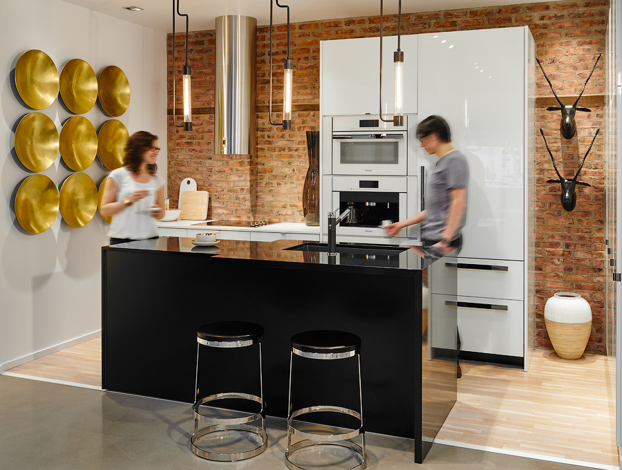 Great Gulf design centre kitchen with brick wall and black island