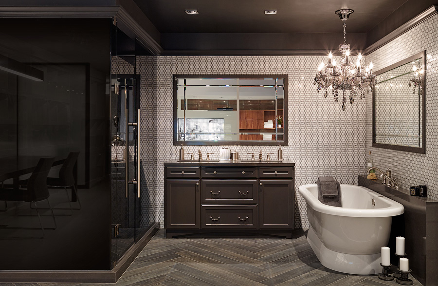 Great Gulf design centre bathroom with brown wood vanity, freestanding tub, and chandelier