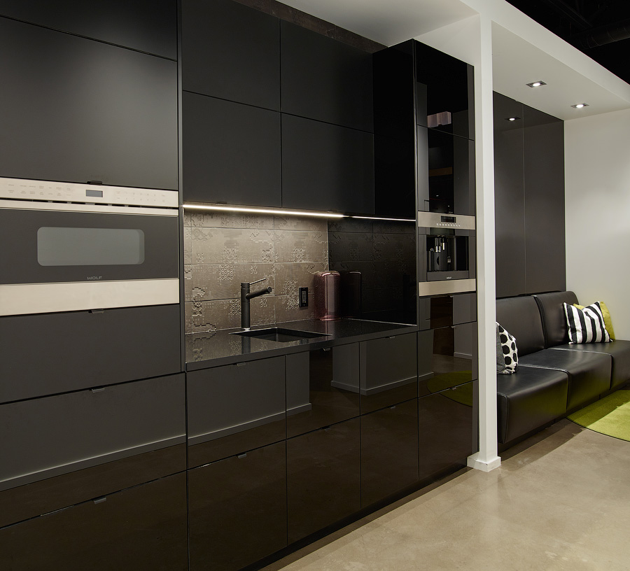 Great Gulf design centre modern kitchen with black cabinetry and appliances