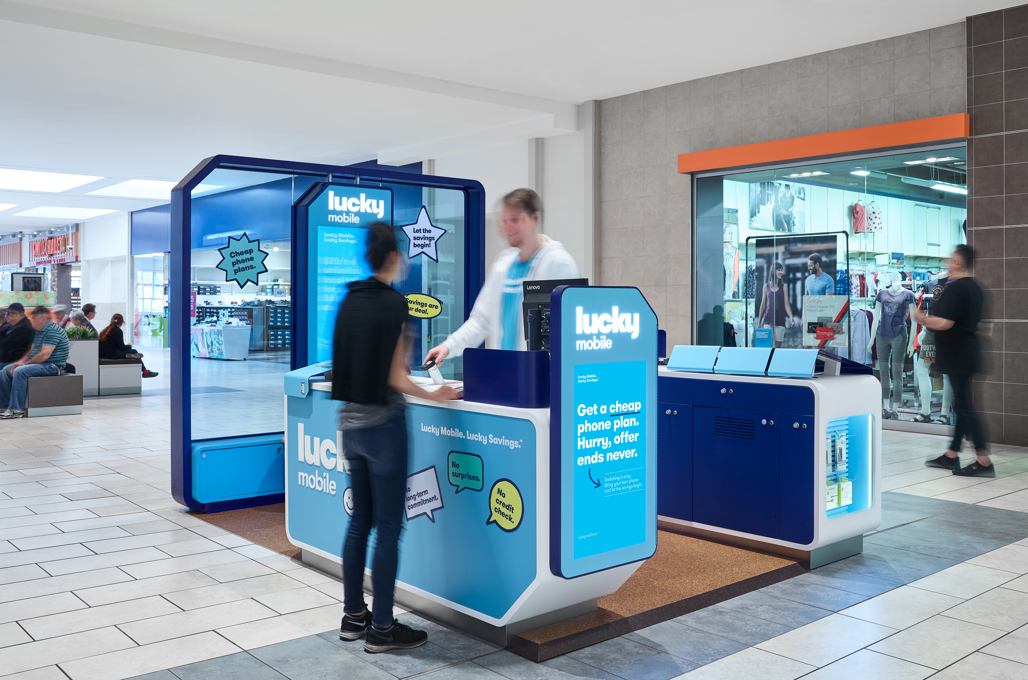 Lucky Mobile Kiosk with blue signage and blue glass wall