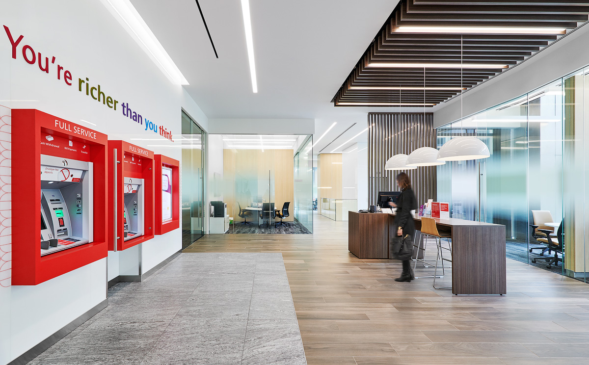 Scotiabank Calgary public space with ATMs, offices, and bar height tables