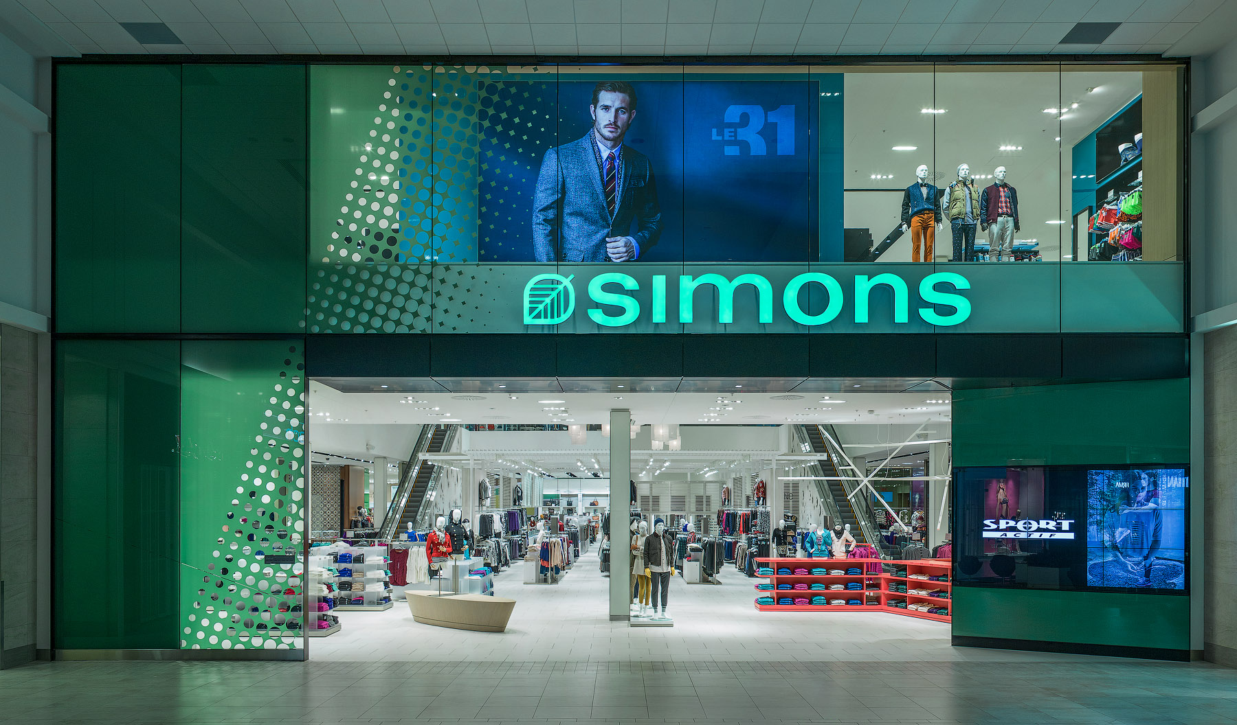 La Maison Simons store entrance with Simons sign and green walls