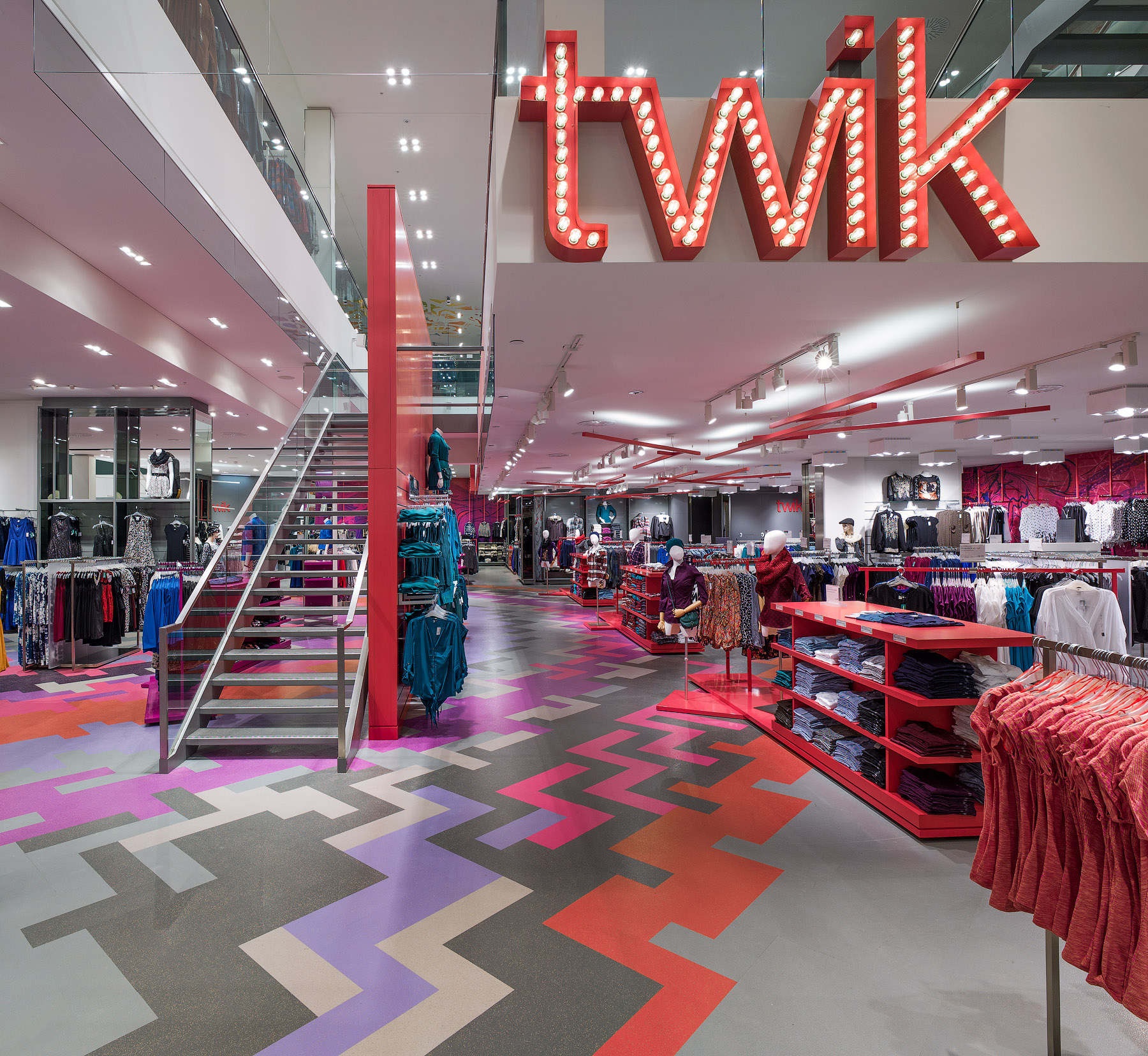 La Maison Simons Twik light up sign and patterned flooring in pink, grey, and orange