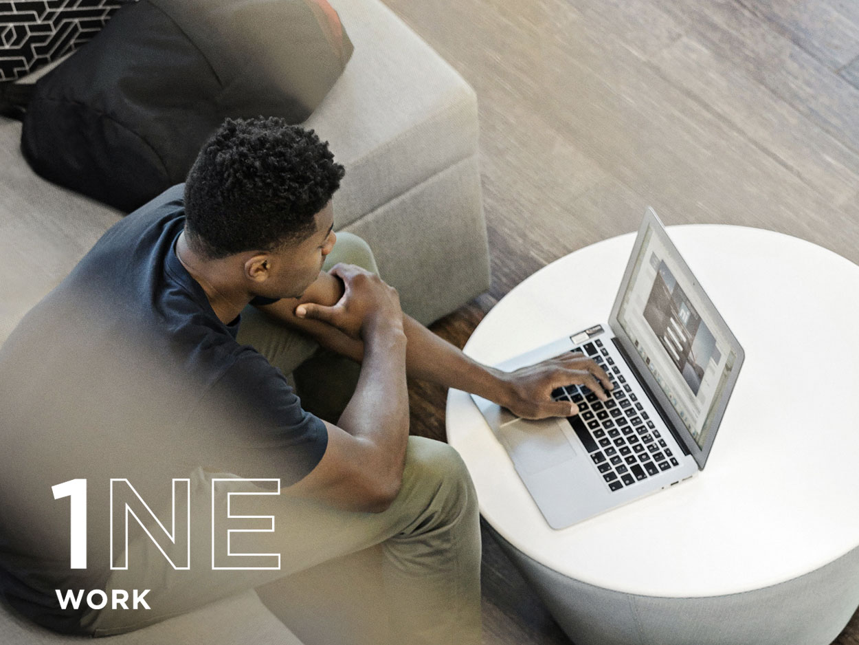 Work, man sitting on couch working on laptop