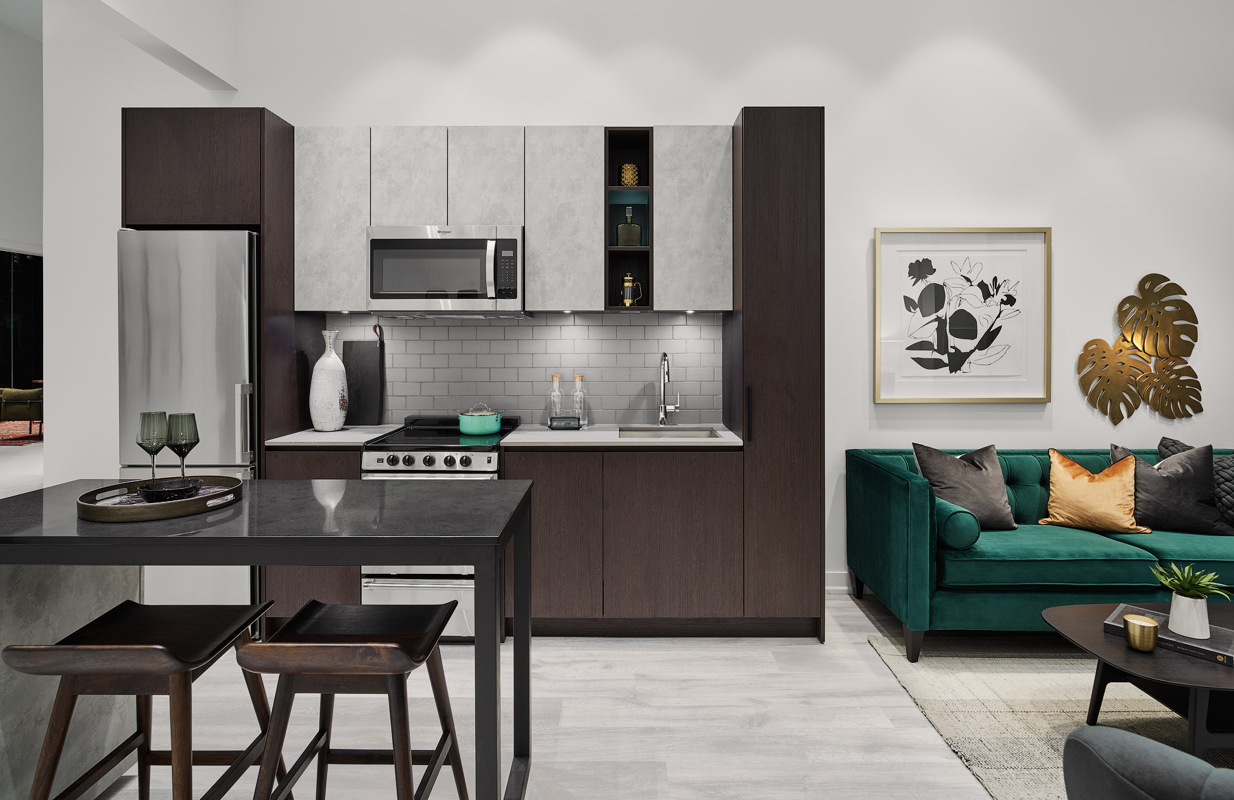 Empire Phoenix suite kitchen with dark brown and white colour blocking cabinetry and island with stools