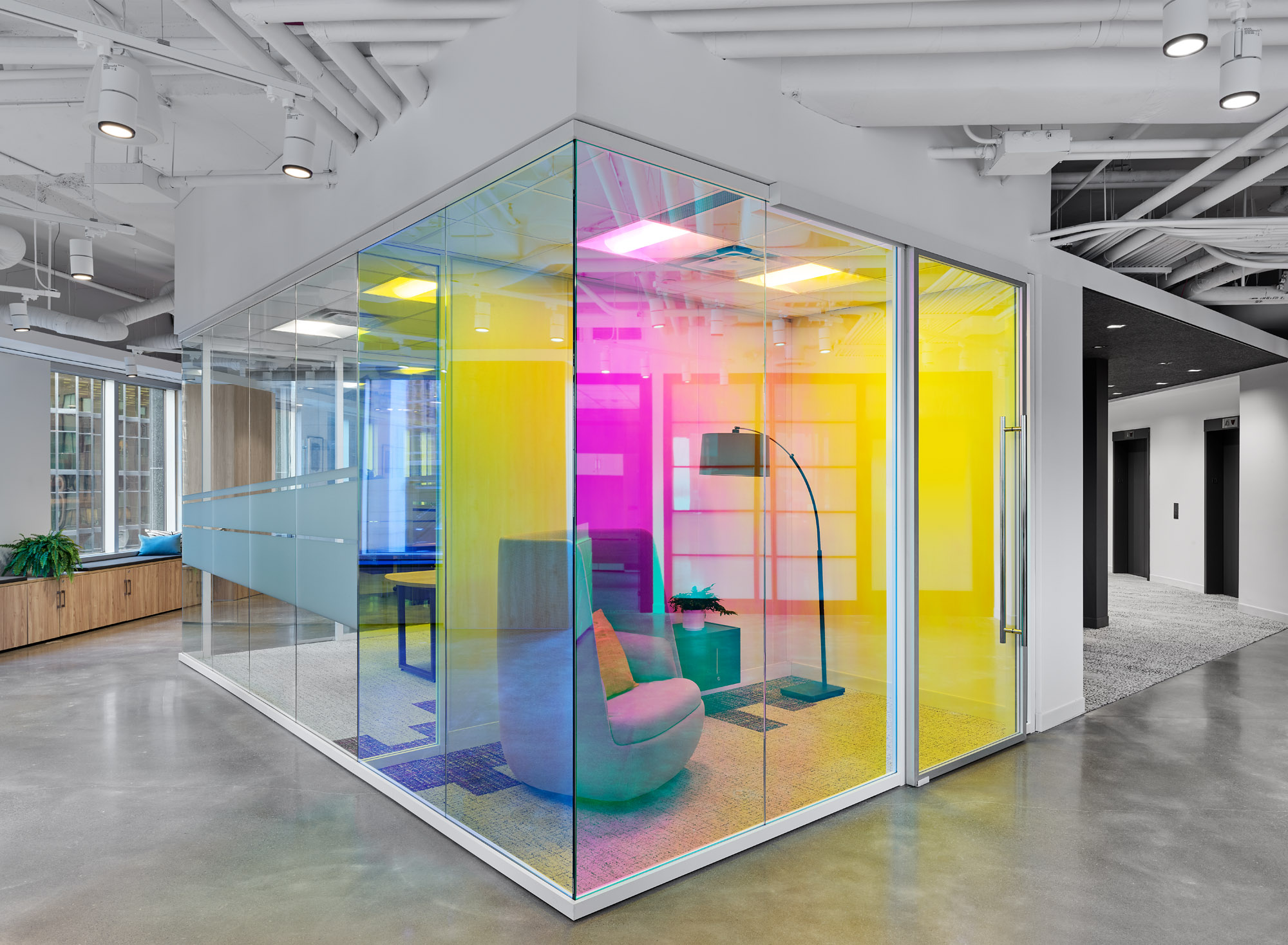 Inscape Toronto showroom, glass walls with bright pink and yellow film