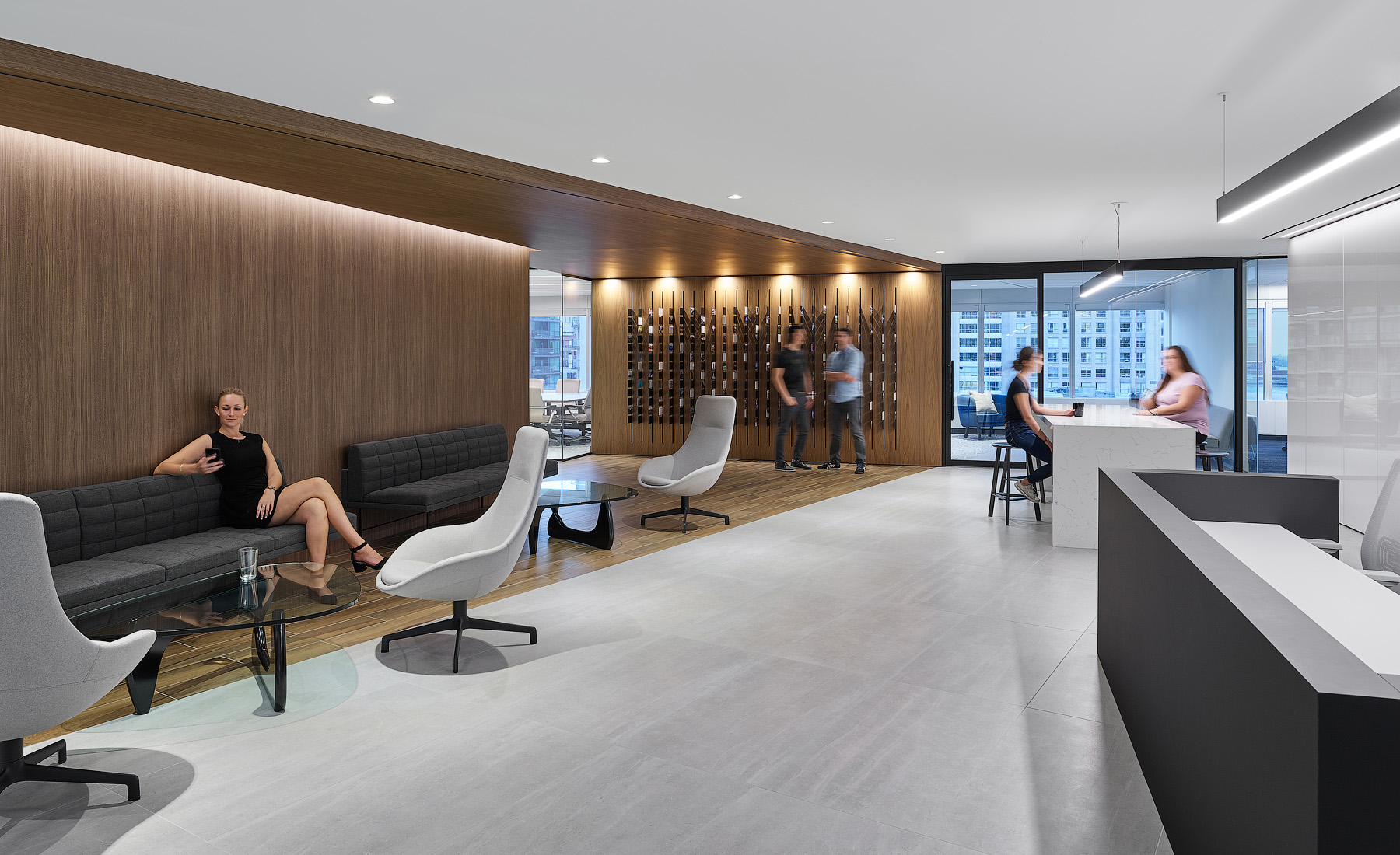 Optimus Toronto lobby with two desks and wood paneling