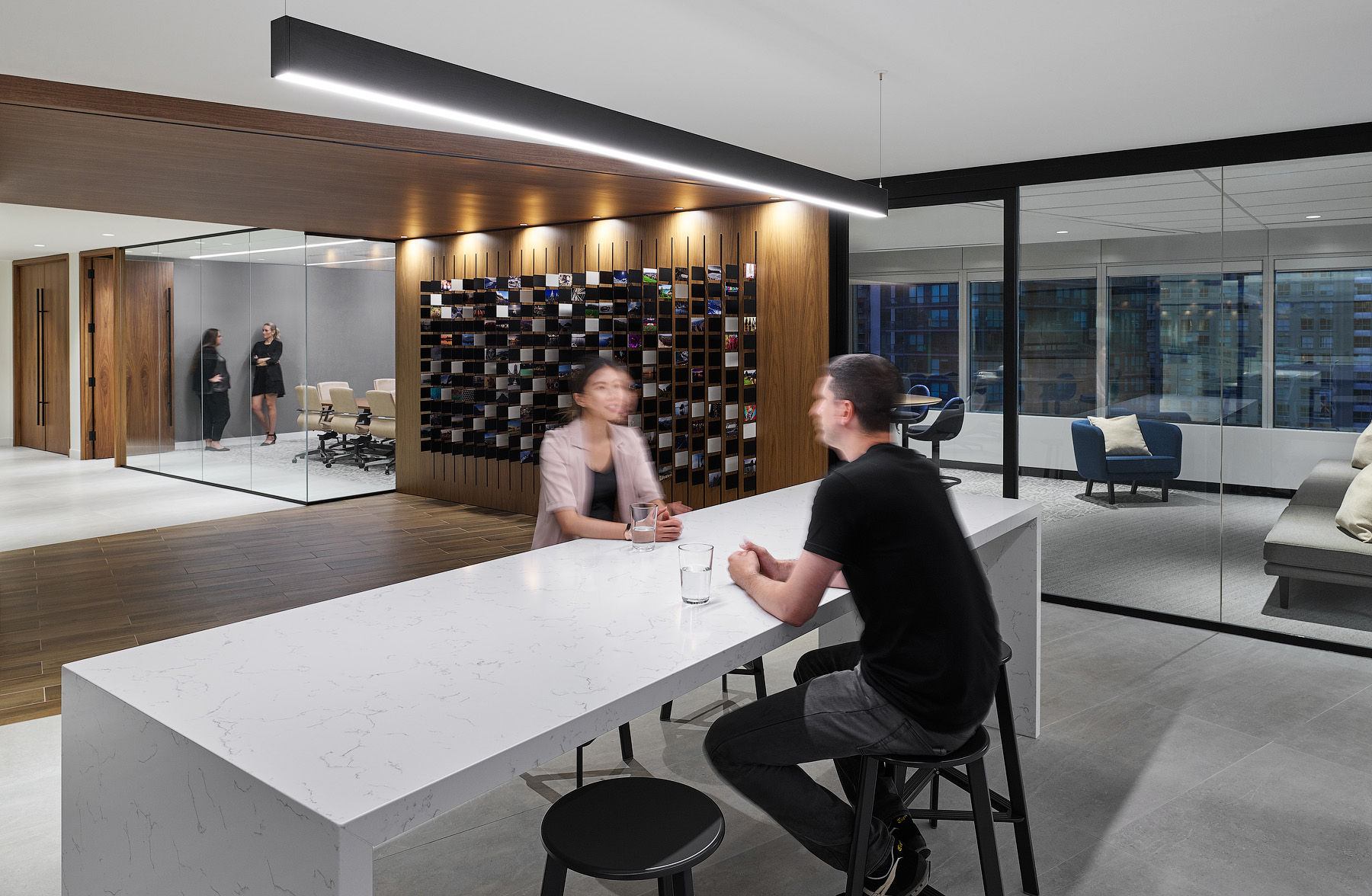 Optimus Toronto lobby, two people sitting at bar height marble table