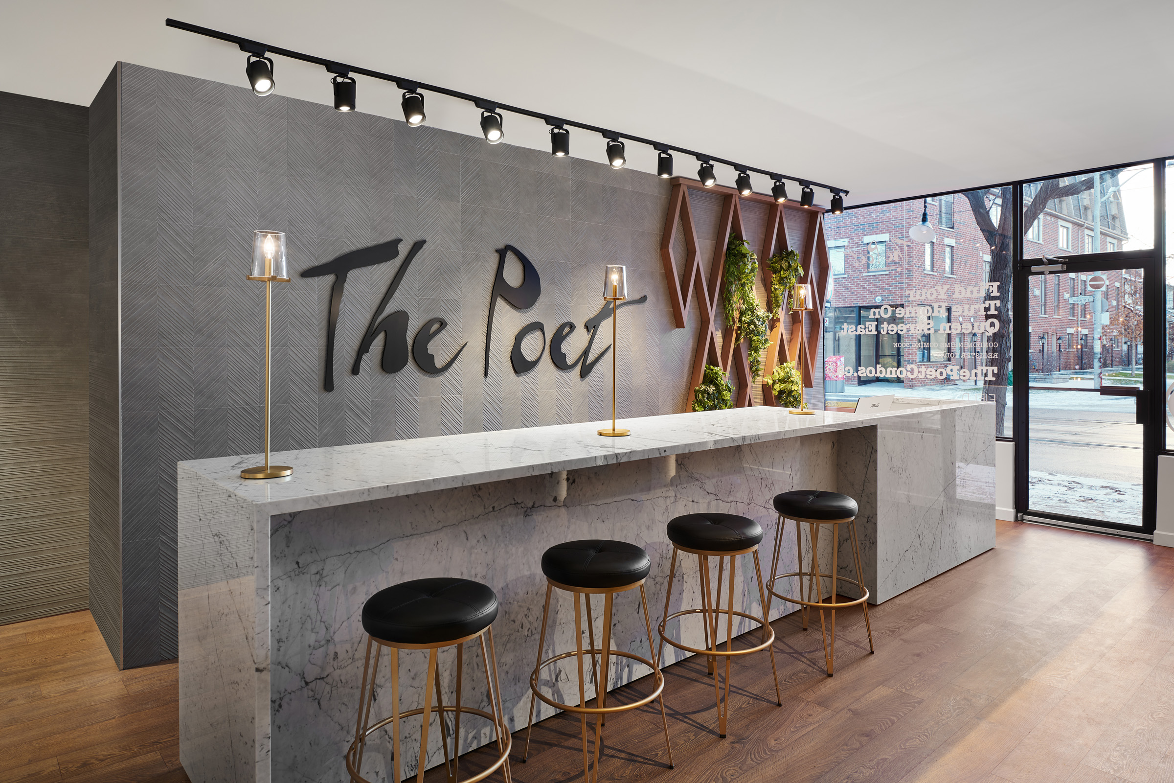 The Poet lobby with logo on wall and marble bar with stools