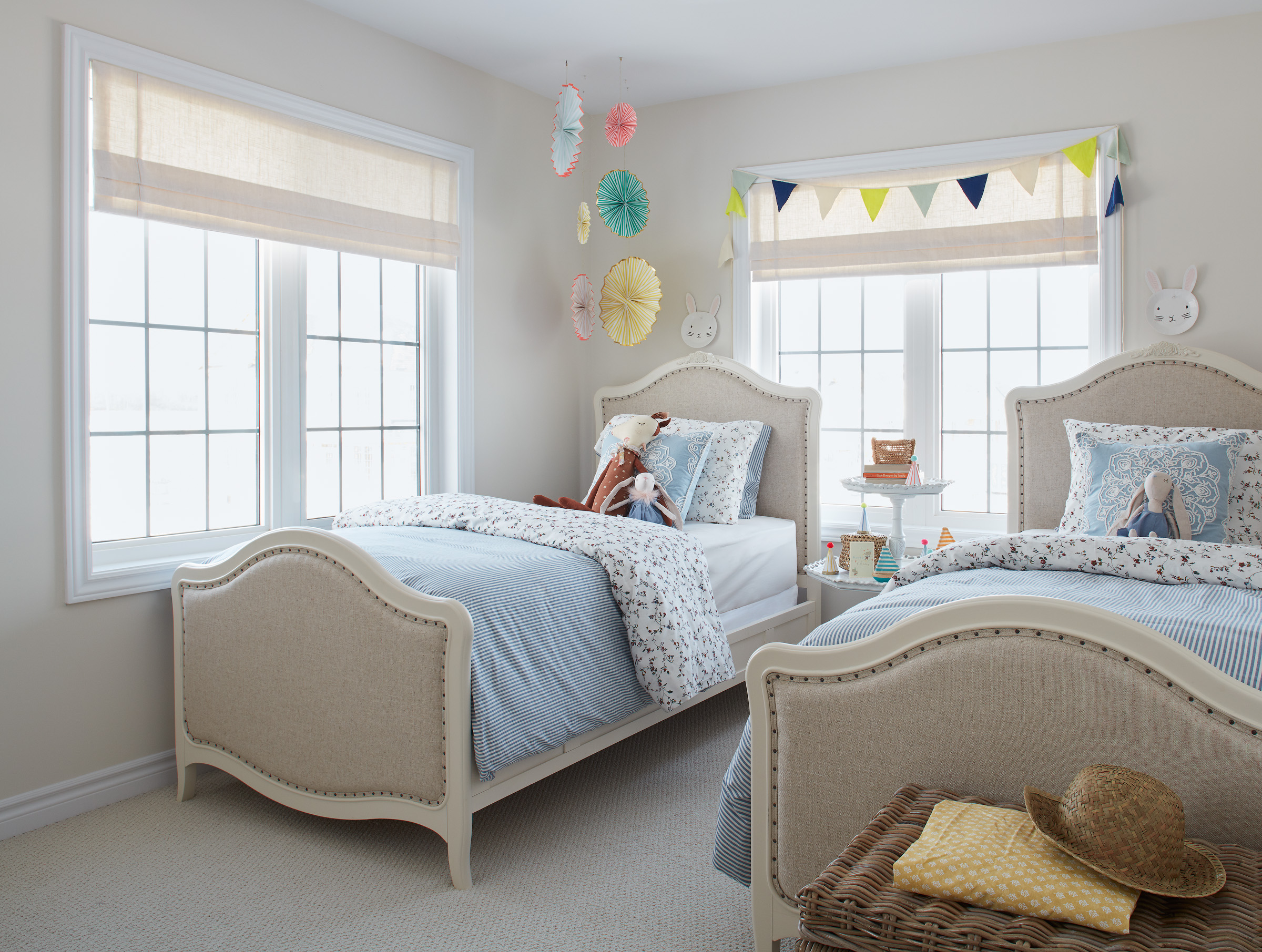 Shabby Chic children's bedroom with two beds, blue bedding, and colourful accents