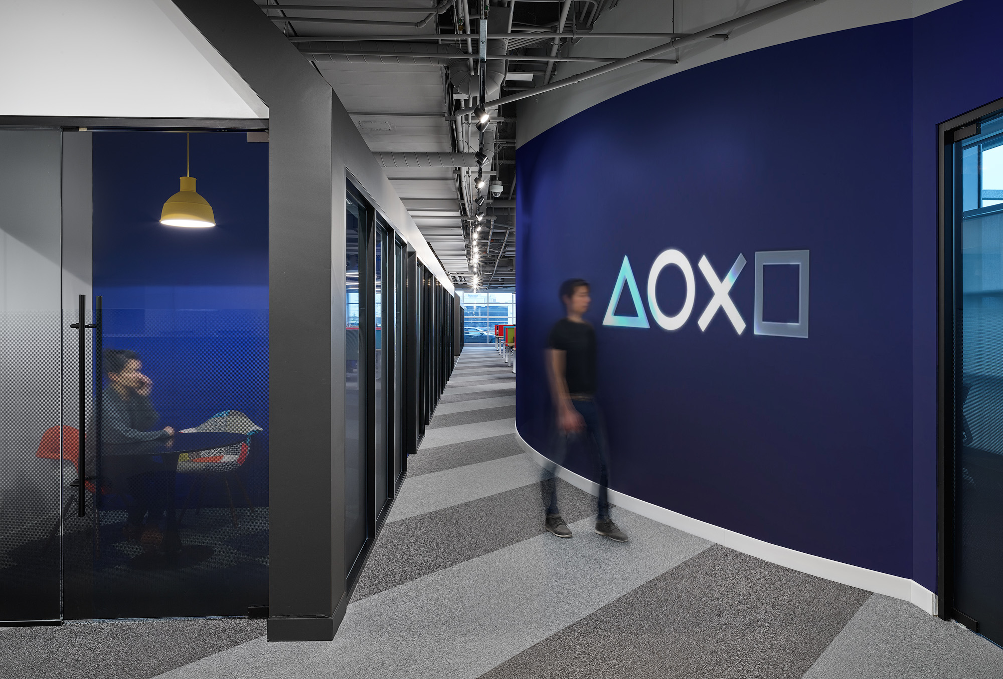Sony SIE Toronto office lobby, blue wall with Playstation logo