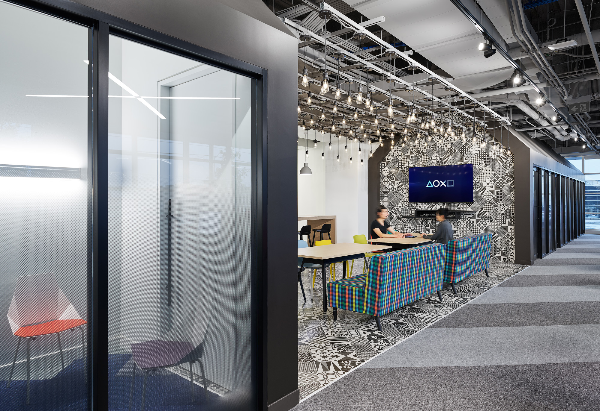 Sony SIE Toronto office with glass wall, black metal, and industrial lighting