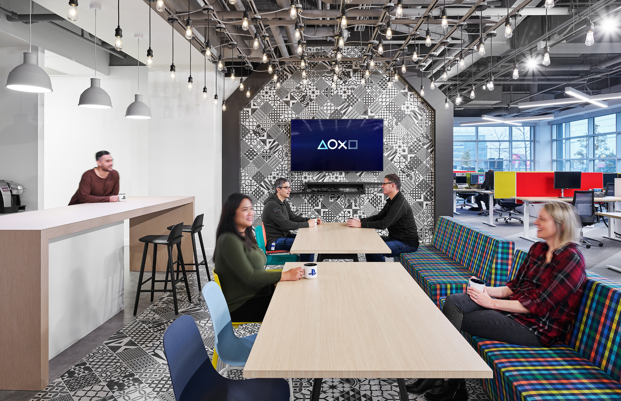 Sony SIE Toronto office lunchroom with bar, tables, and bench seating