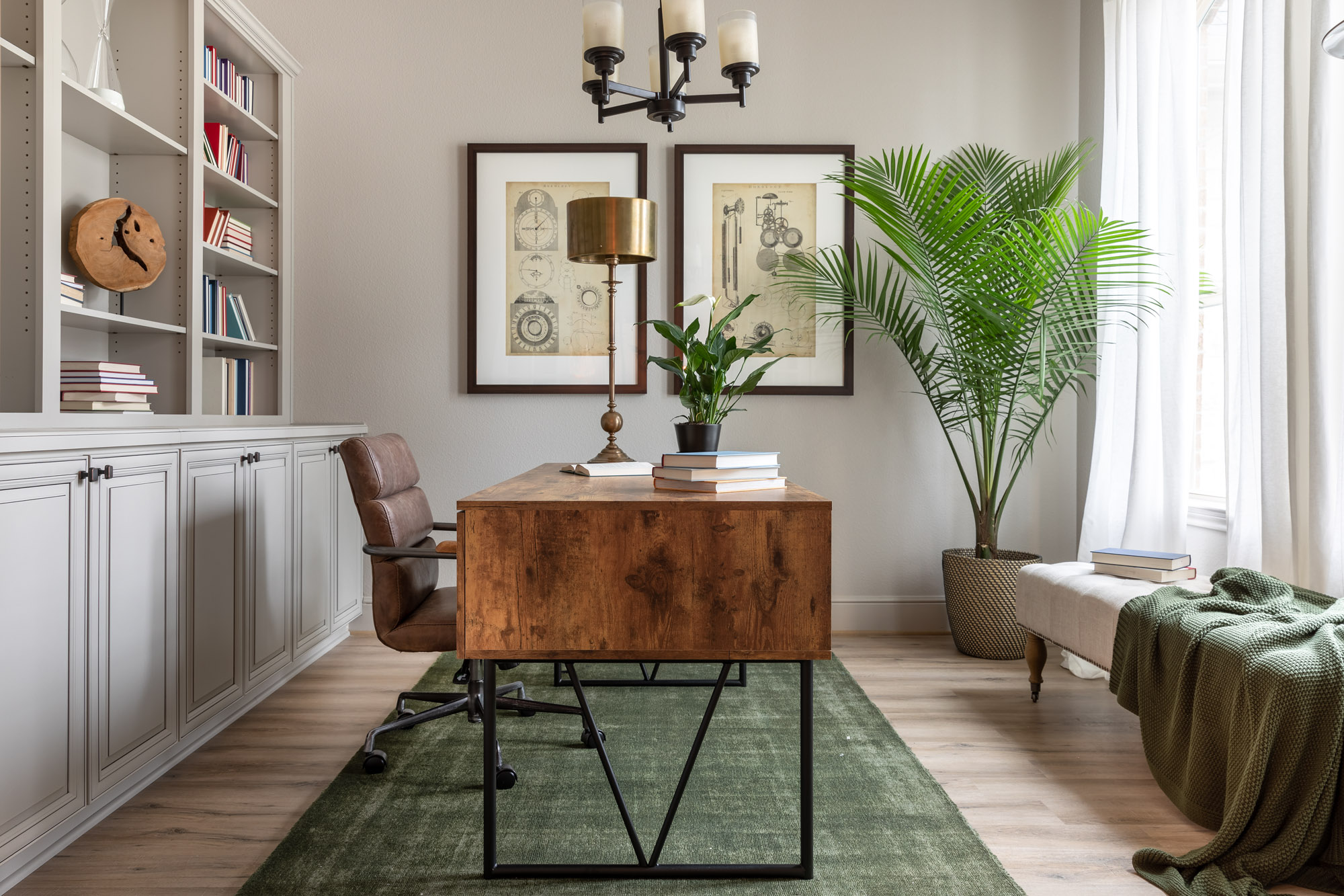 Harper's Preserve study with wood desk, leather chair, large plant, and bright green rug