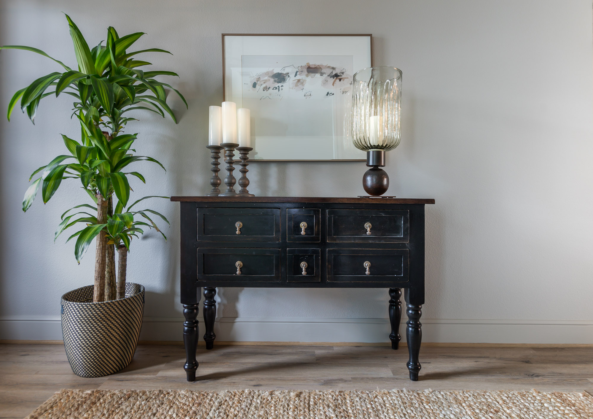 Harper's Preserve entry with traditional dark wood console table and large plant