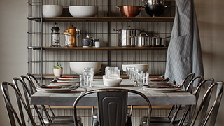 Industrial Ranch kitchen with distressed metal chairs and industrial baker's rack