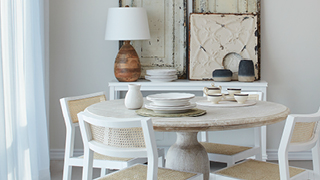 Shabby Chic kitchen with white wood chairs and round distressed wood table