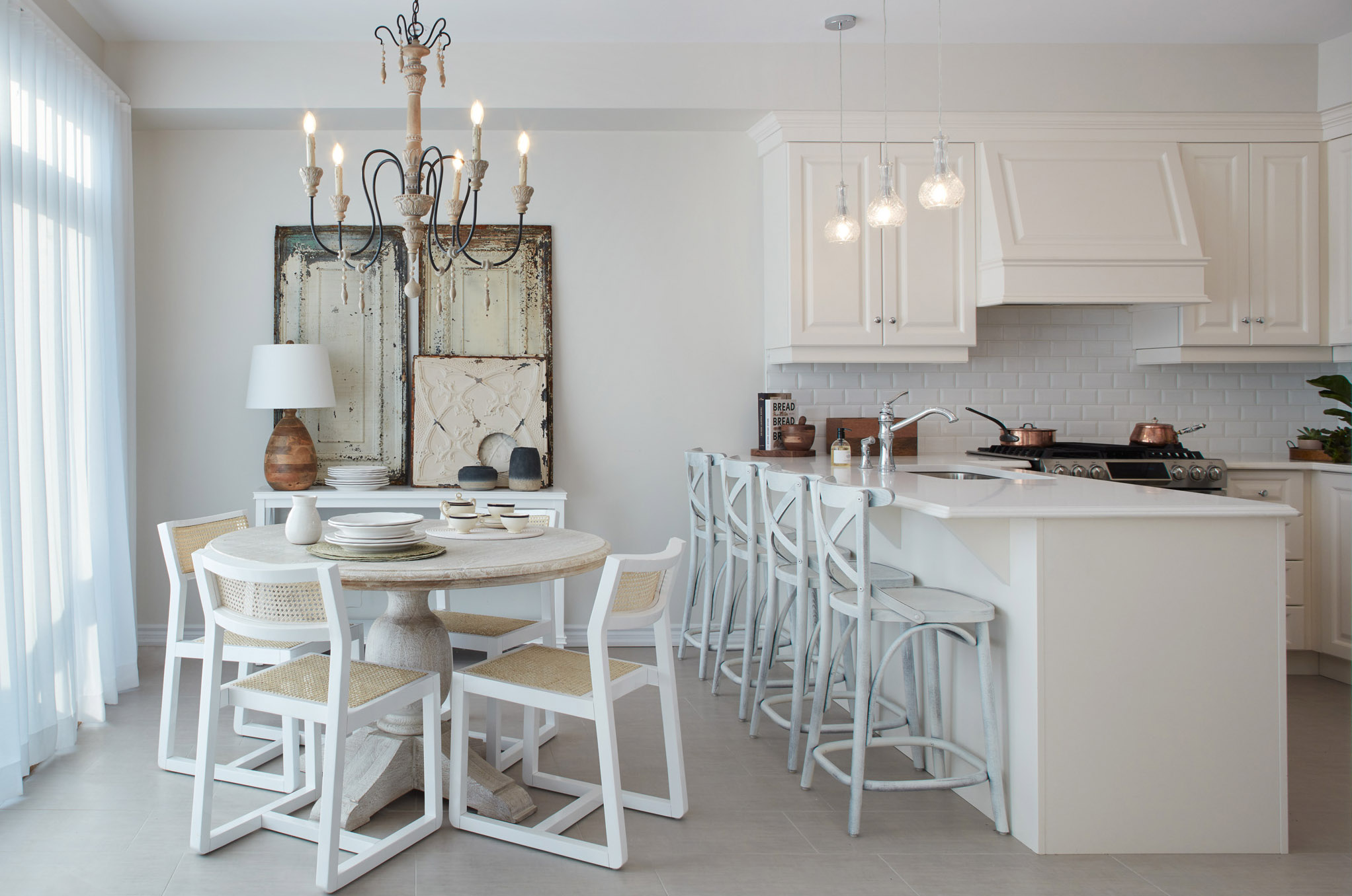 Shabby Chic kitchen with white furniture, white cabinets, and light wood floors