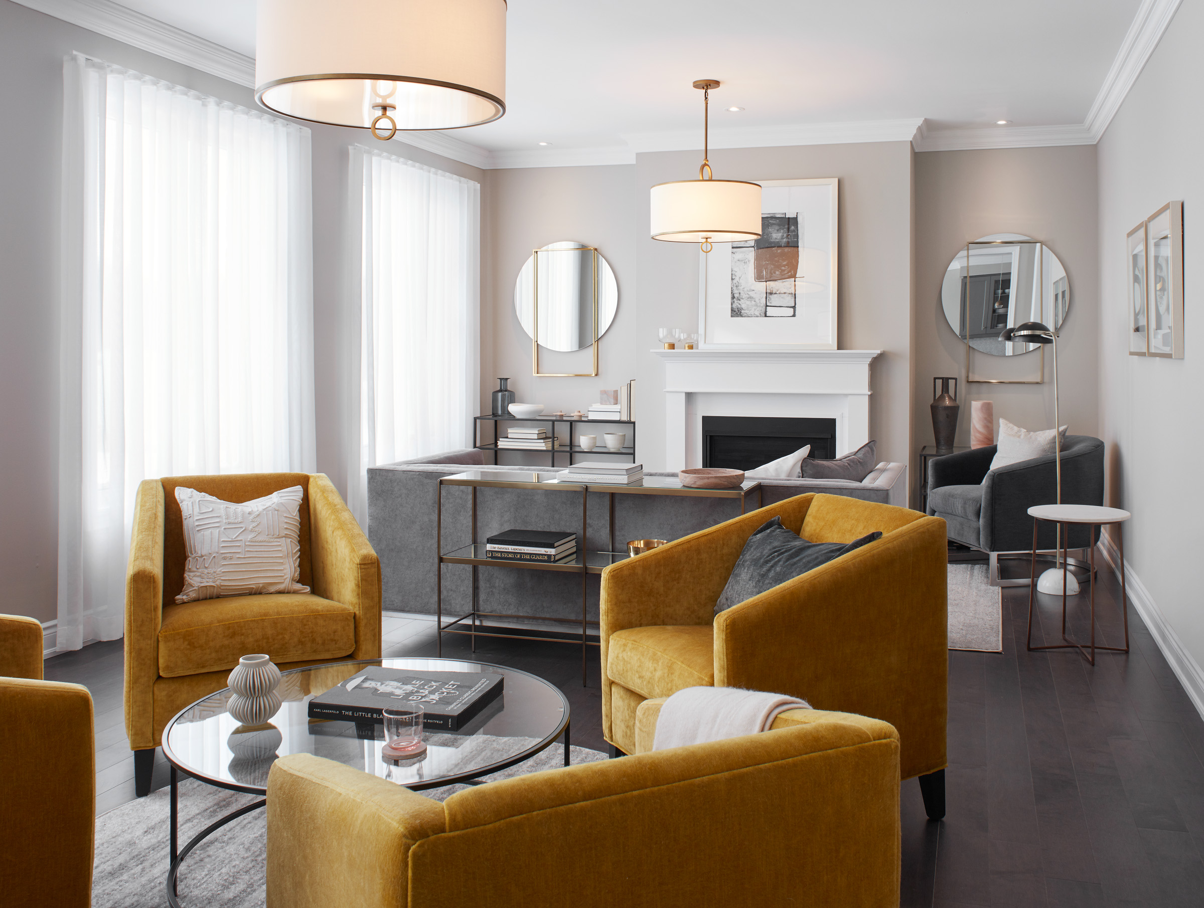 Manor Estate living room with bright yellow chairs and metal accent tables