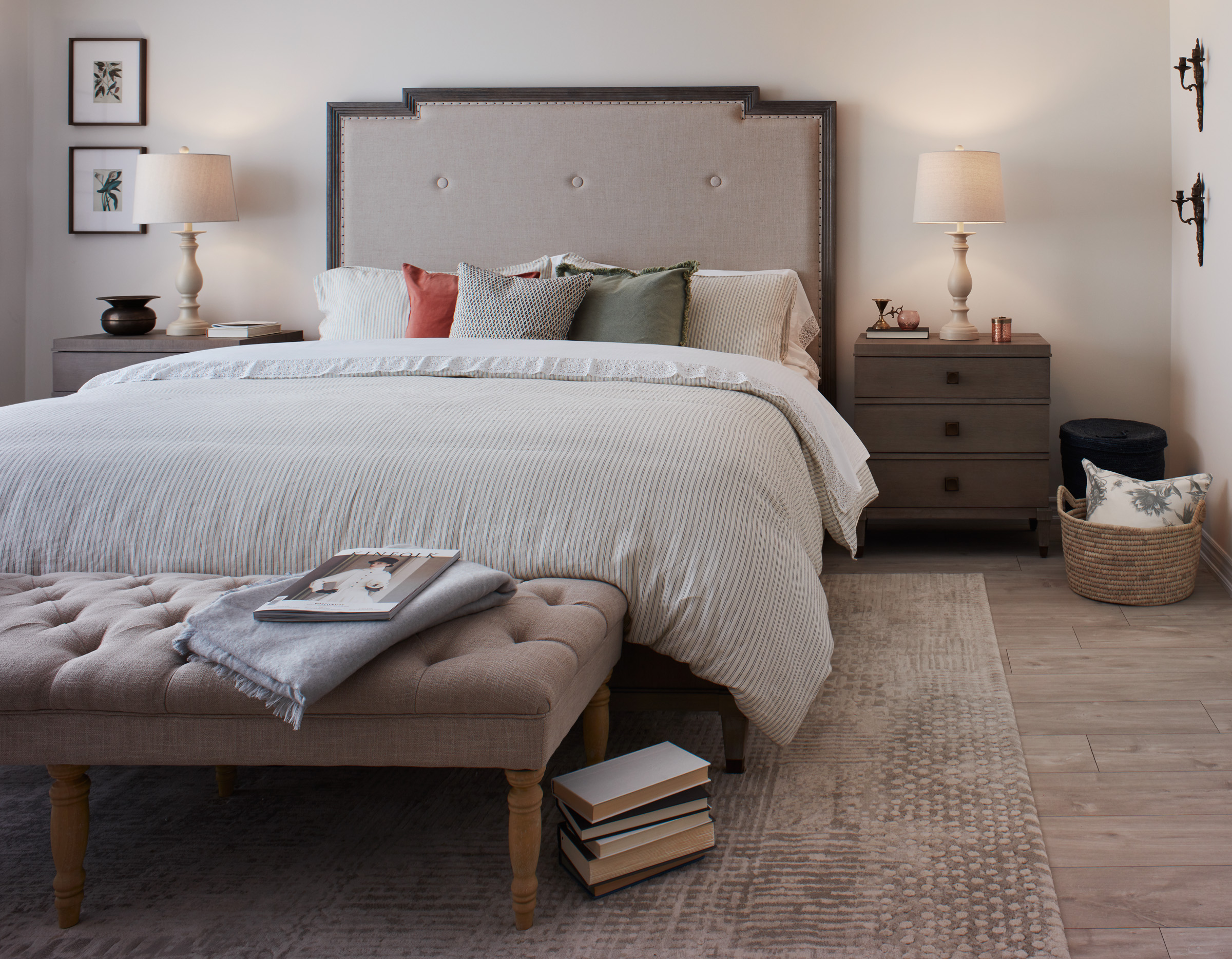 Shabby Chic master bedroom with upholstered bed and neutral coloured bedding, walls, and rug