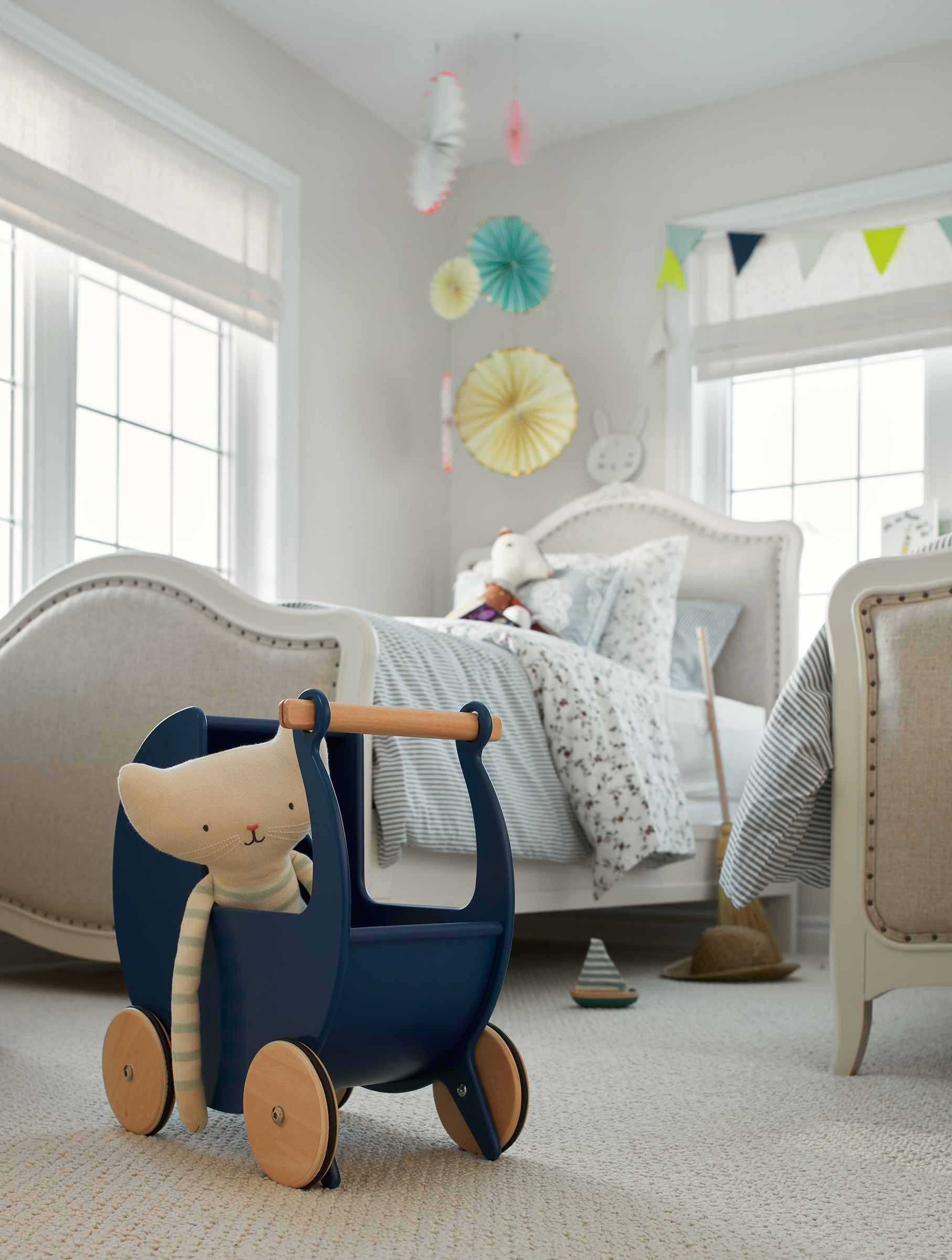 Shabby Chic children's bedroom with close up of blue toy on floor