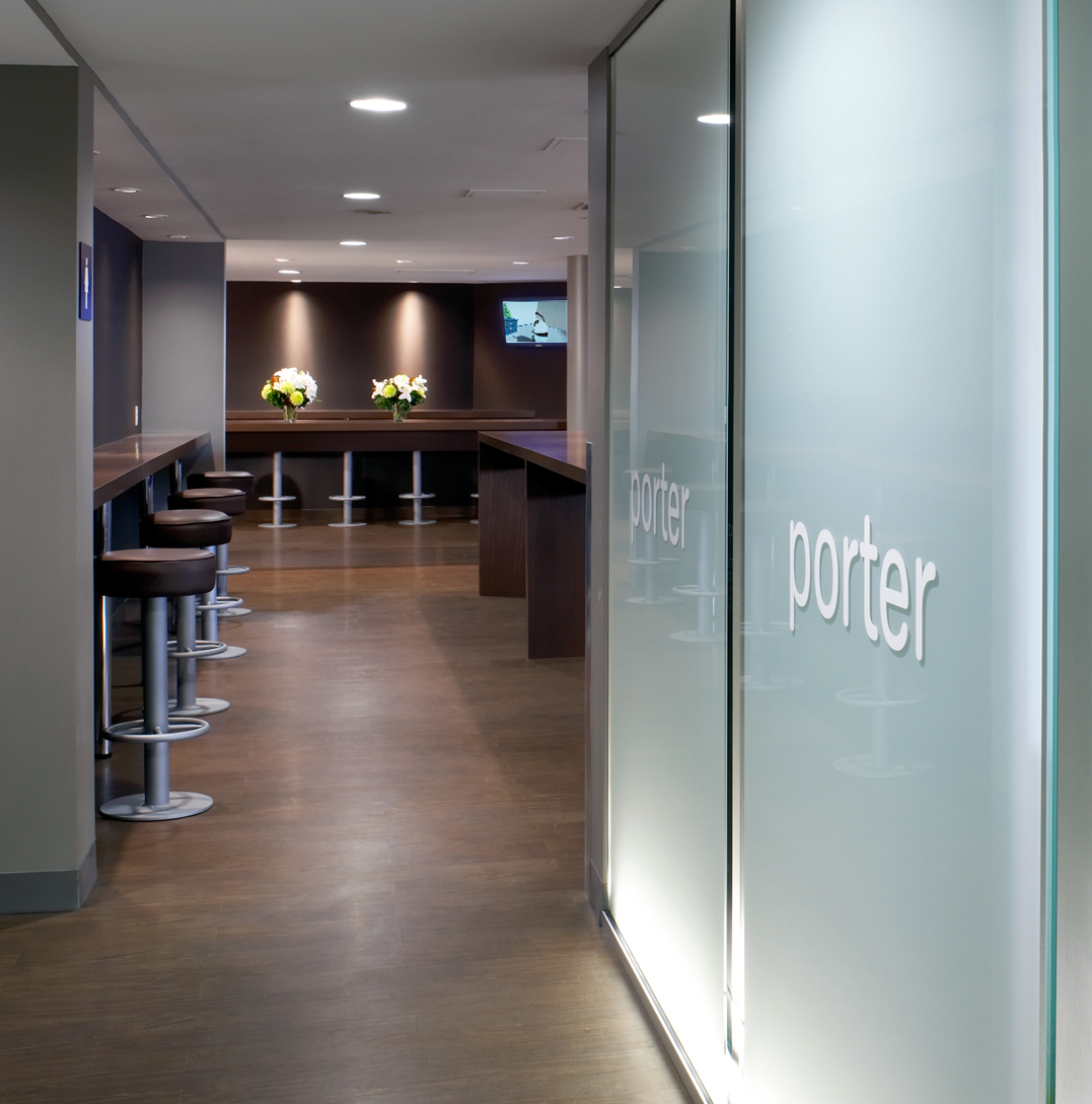 Porter Lounge with logo on glass wall and seating