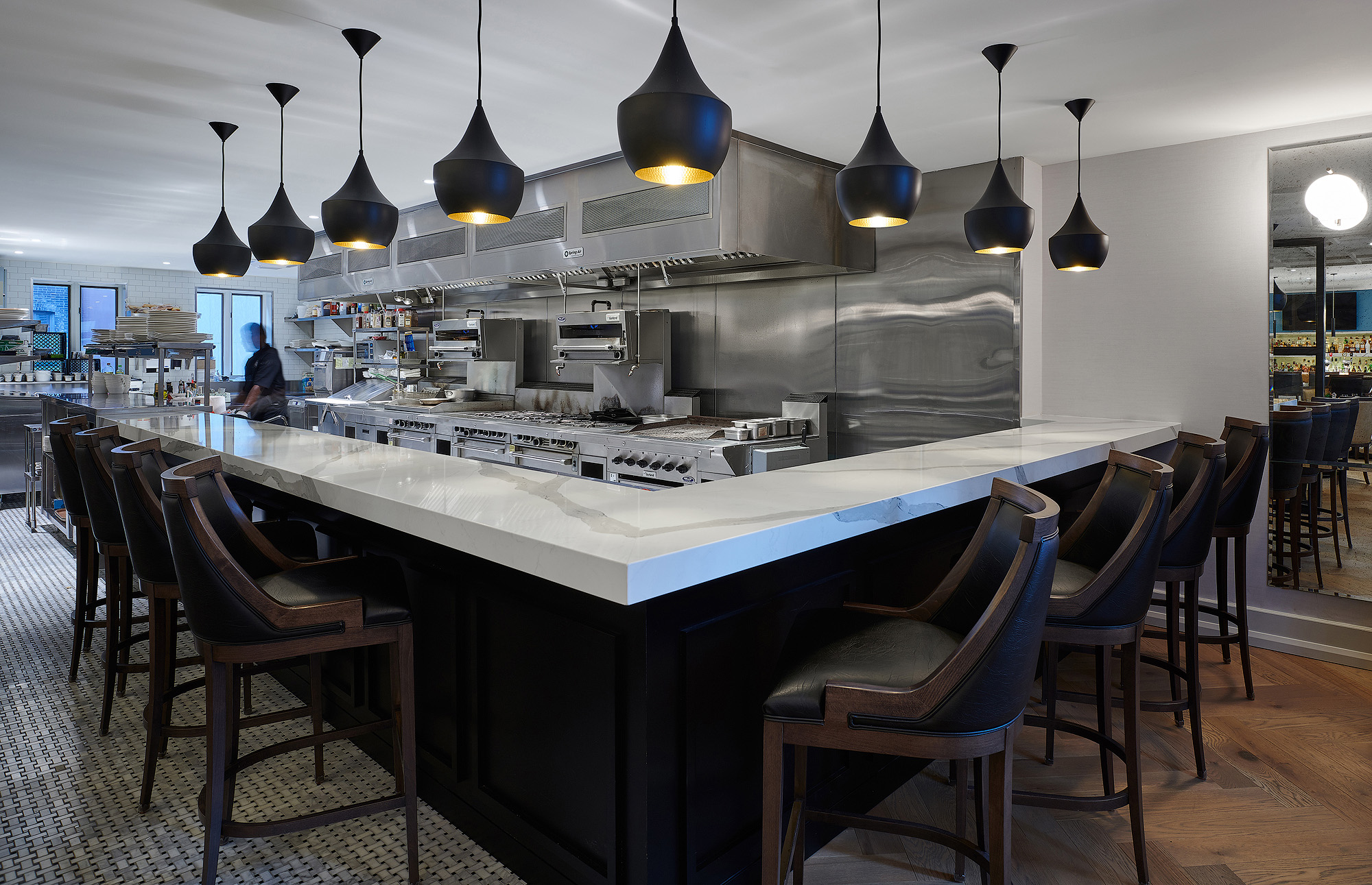 National Club bar with black pendant lighting and white marble countertop
