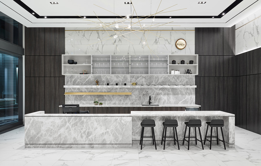 Transit City Bar Buca made of white marble and dark brown wood, with bar stools and brass lighting